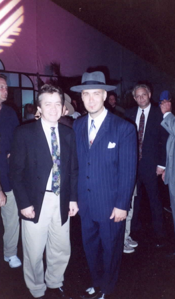 "Big Bad Voodoo Daddy - Scotty Moore of Big Bad Voodoo Daddy with Nik's Gary Webb at a private Super Bowl party in Miami. The event, which also featured ""Fever - The Wrath of Polyester,"" was held at the house on Key Biscayne where the movie Scarface was filmed."