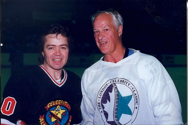 Gordie Howe - NHL Legend Gordie Howe sweating with Nik's Gary Webb at Hollywood Celebrity All-Star hockey game in London, Ontario.